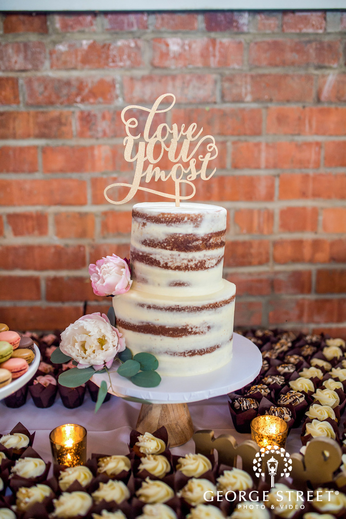 delightful two tier cake with topper wedding photography