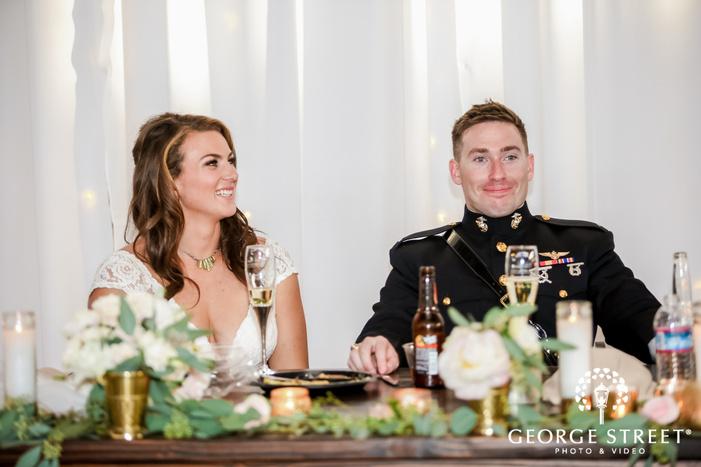 elegant bride and groom on table wedding photo