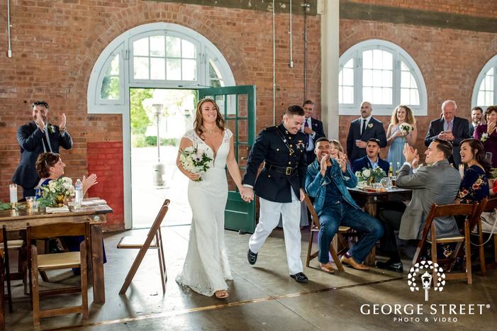 happy couple reception entrance wedding photography