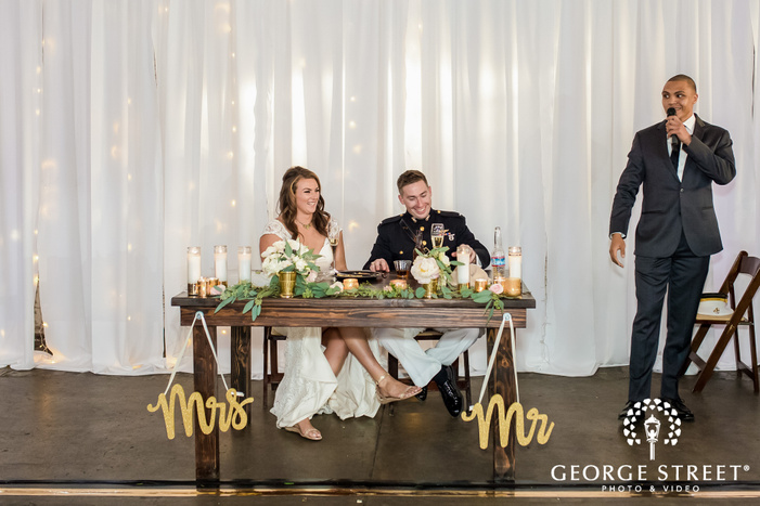 joyful bride and groom during guest speech wedding photos