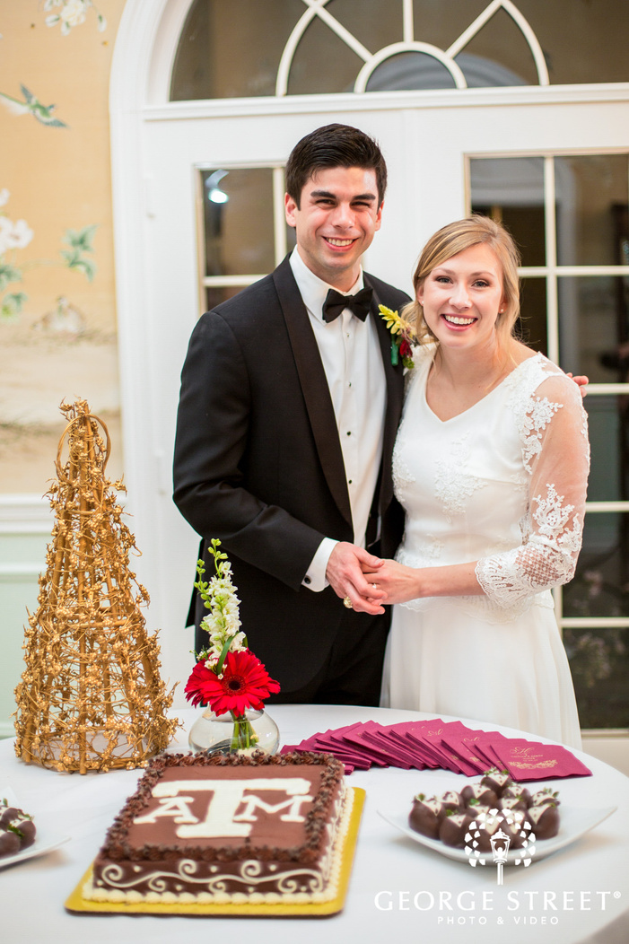 adorable bride and groom at cake cutting ceremony
