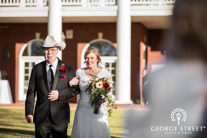 cute bride and father at ceremony entrance