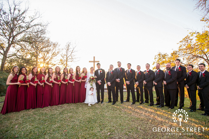 happy group in green field wedding photography
