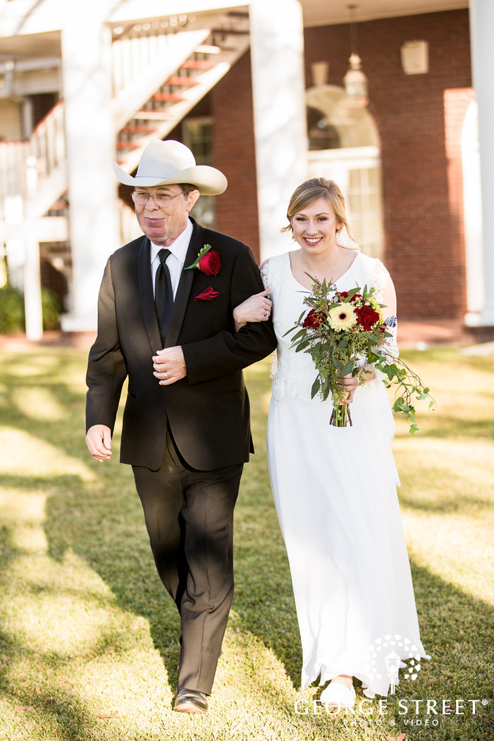 joyful bride and father walking down the aisle
