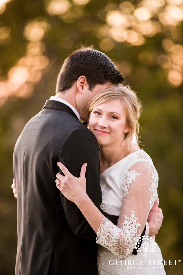 joyful bride and groom in lawn