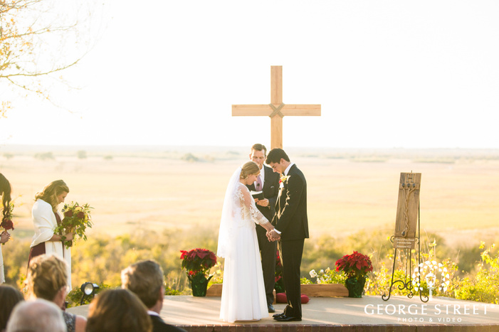 mesmerizing bride and groom at wedding ceremony