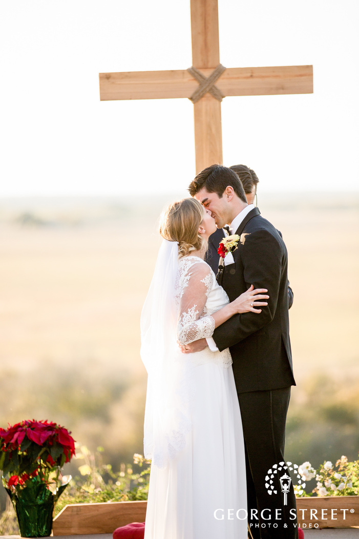 romantic bride and groom first kiss