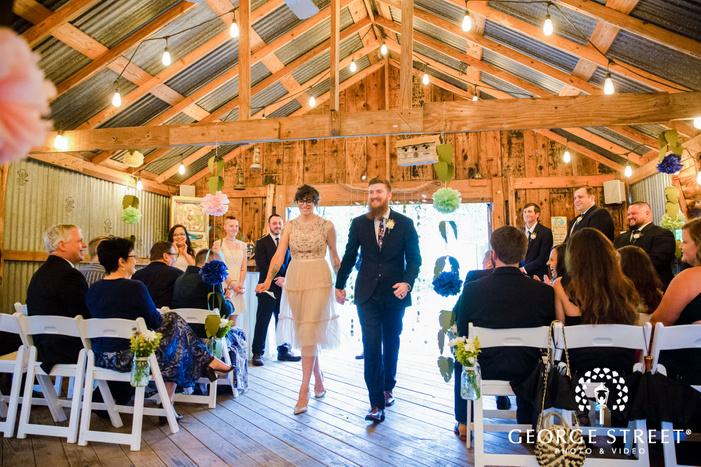 joyful bride and groom ceremony exit wedding photo