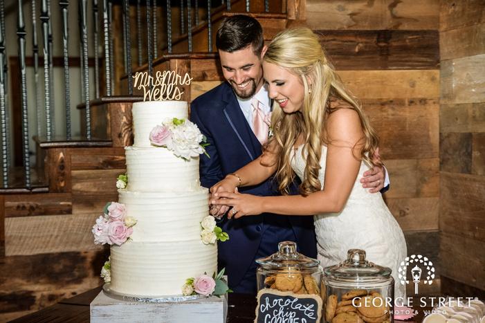 cute bride and groom cake cutting wedding photos