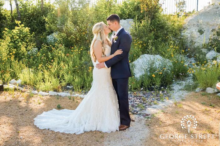 romantic bride and groom in garden at stone crest venue in dallas fort worth
