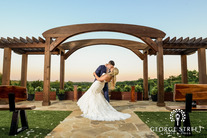romantic bride and groom on wedding altar at stone crest venue in dallas fort worth