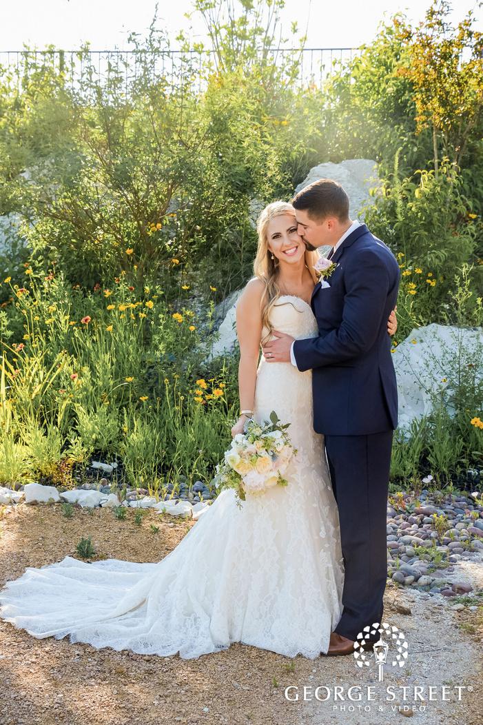sweet bride and groom in garden wedding photography