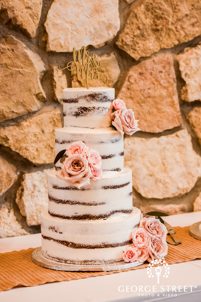 delightful four teir cake with topper wedding photography
