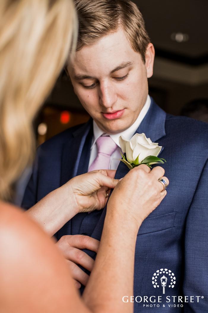 handsome groom getting ready wedding photos