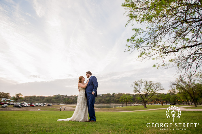 charming bride and groom in green field at blissful hill in austin