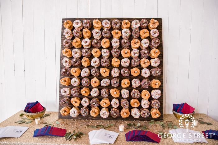 delightful reception donut wall wedding photo