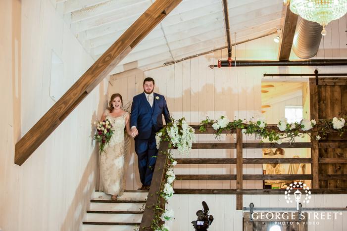 excited bride and groom reception entrance wedding photos