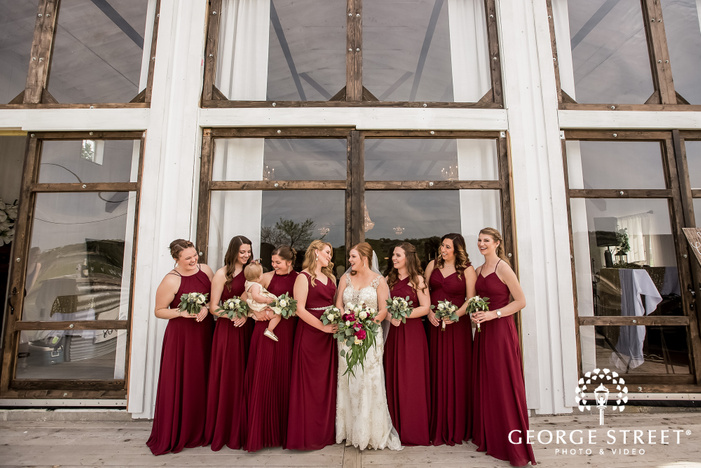 gorgeous bride and bridesmaids in front of entrance wedding photography
