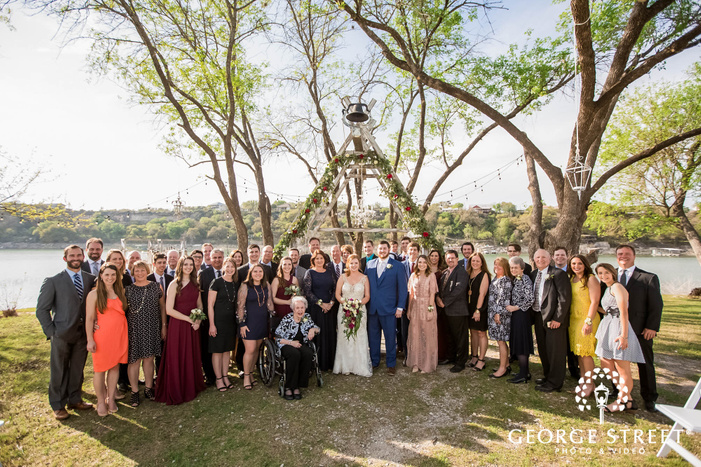 happy couple and family at wedding altar wedding photography