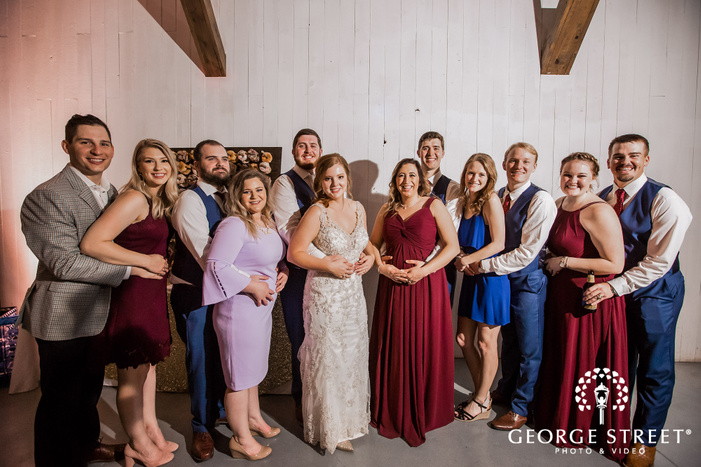 joyous couple and guests in reception hall wedding photography