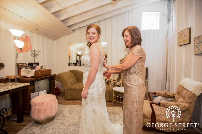 pretty bride getting ready in bridal room wedding photos