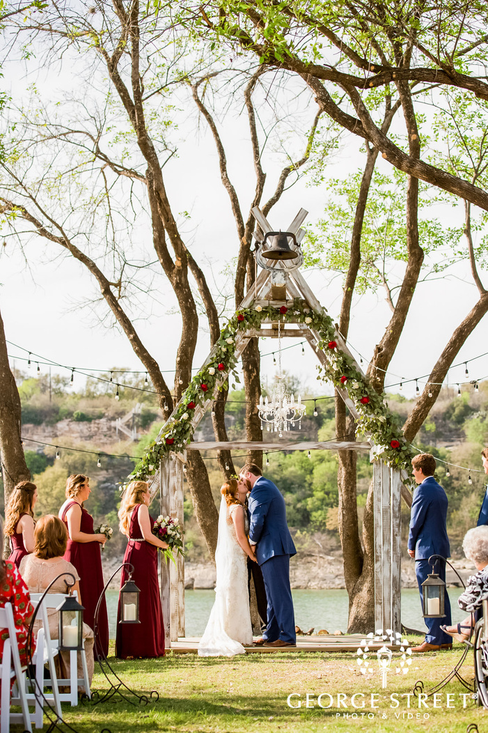 romantic bride and groom first kiss at blissful hill in austin
