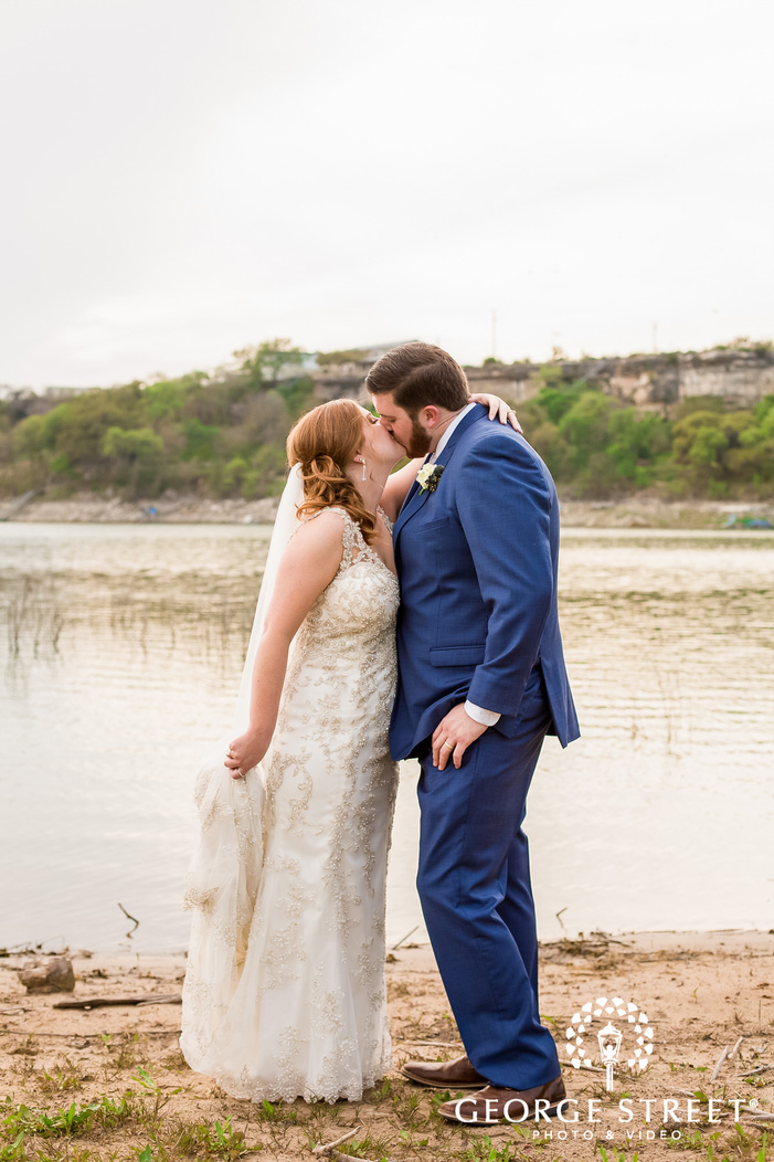 romantic bride and groom near lake at blissful hill in austin