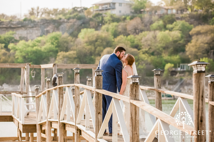 romantic bride and groom on bridge at blissful hill in austin