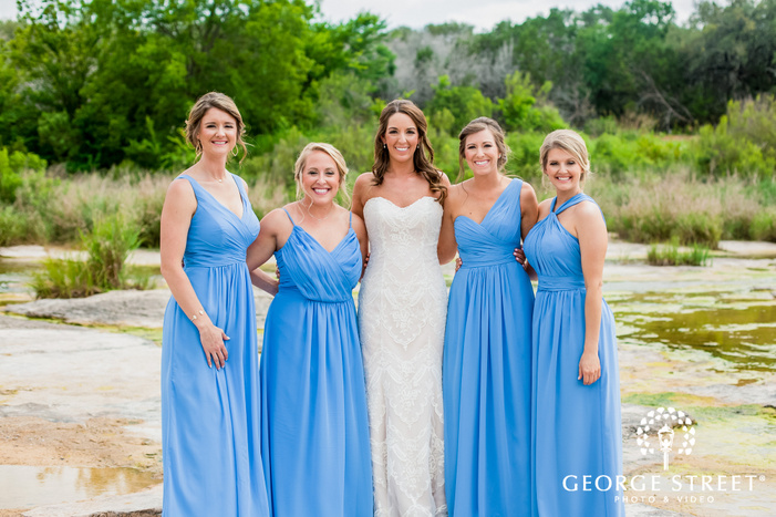 beautiful bride and bridesmaids at king river in austin wedding photography