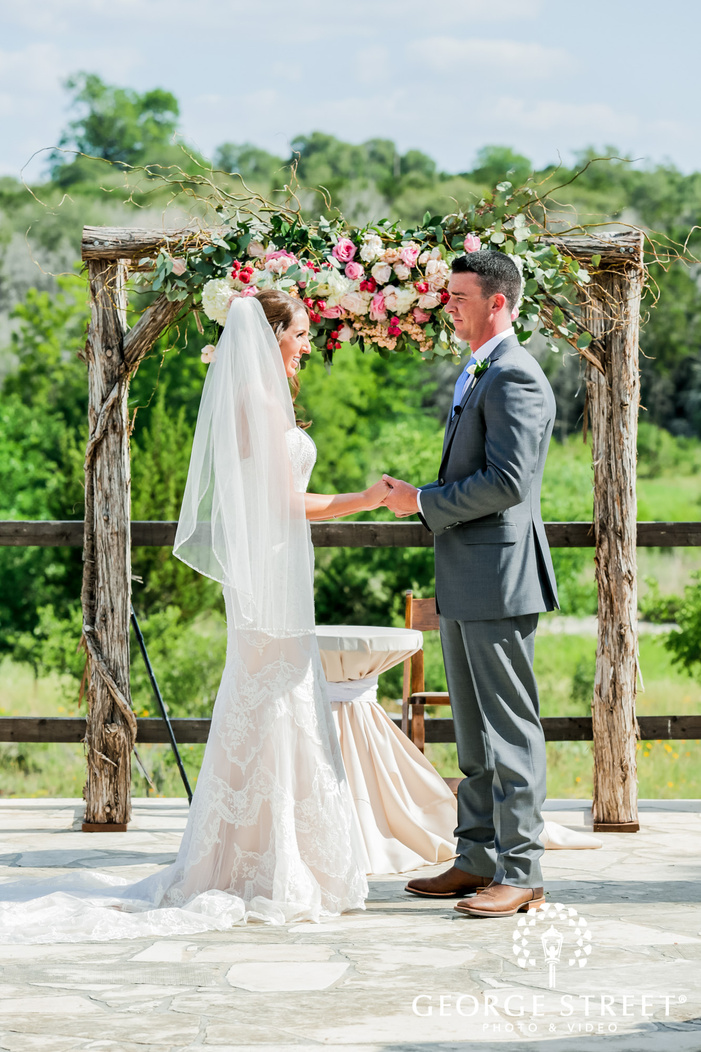 blissful bride and groom wedding vows exchange at altar in austin wedding photos