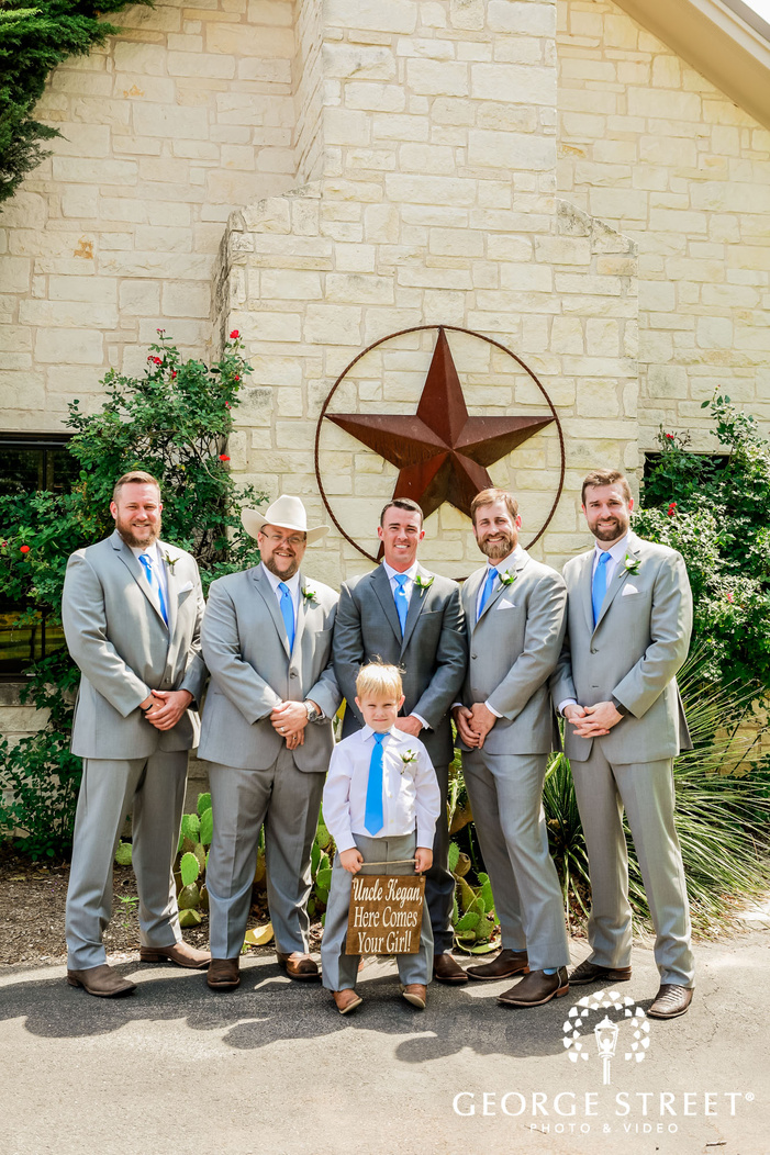 charming groom and groomsmen infront of king river ranch wedding photography