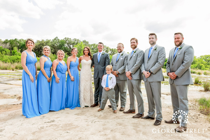 cheery couple and group at king river in austin wedding photography
