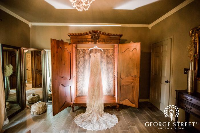 elegant bridal attire in getting ready room wedding photo
