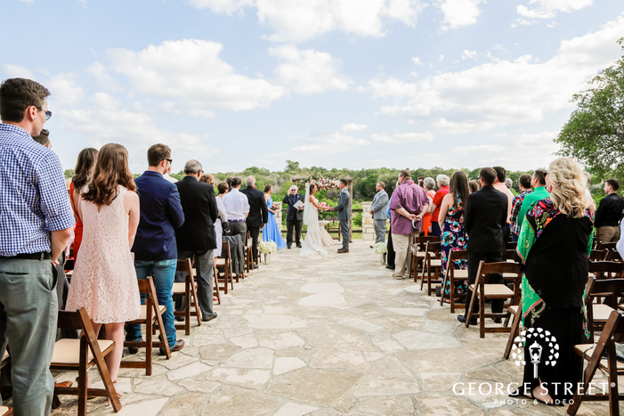 happy wedding ceremony at king river ranch in austin wedding photo