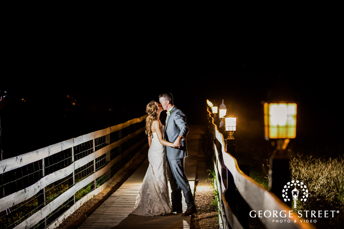 intimate bride and groom on bridge at king river in austin wedding photography