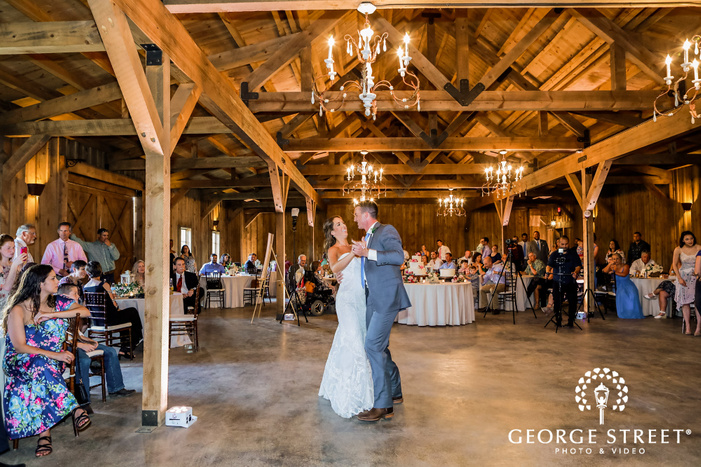 joyful bride and groom first dance in reception at king river ranch wedding photos