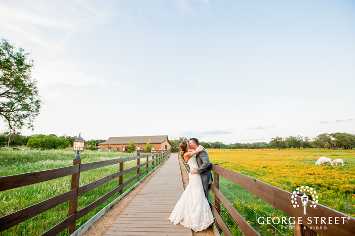 lovely bride and groom on wooden bridge at king river ranch in austin wedding photography