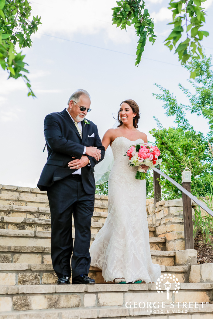 pretty bride and father walking down the steps wedding photo