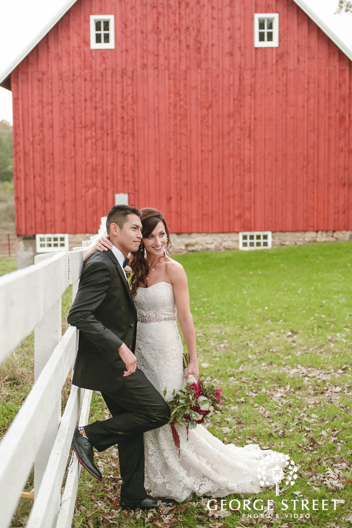 adorable bride and groom in green field at the almquist farm in minneapolis