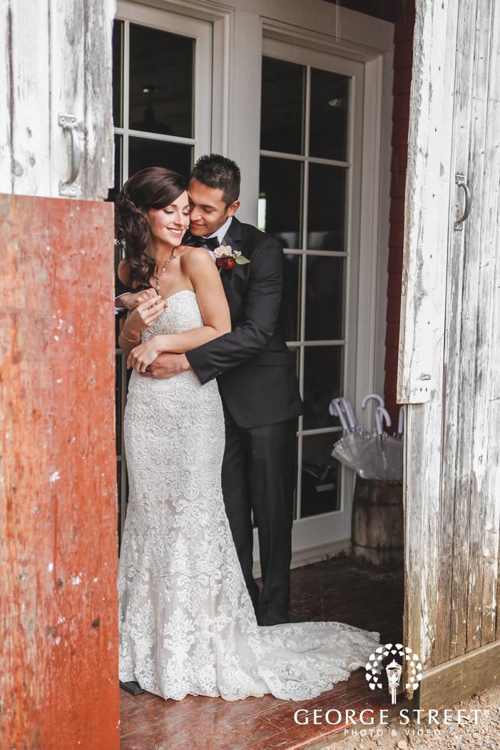 adorable bride and groom on entrance door wedding photography