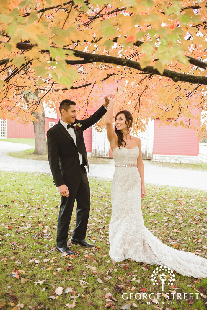 charming bride and groom under autumn tree wedding photography