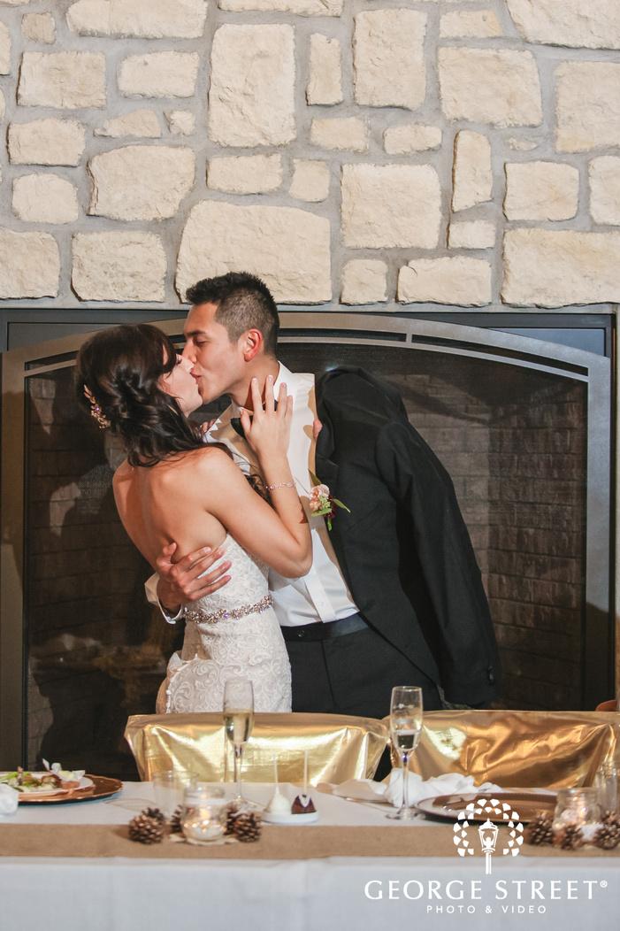 romantic bride and groom on reception table wedding photos
