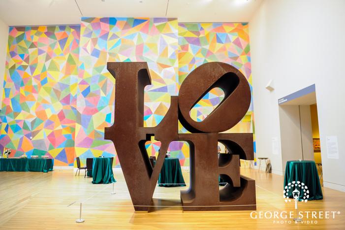 beautiful wooden love sculpture wedding photo