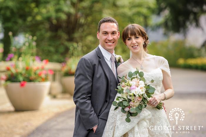 charming bride and groom on walkway wedding photography