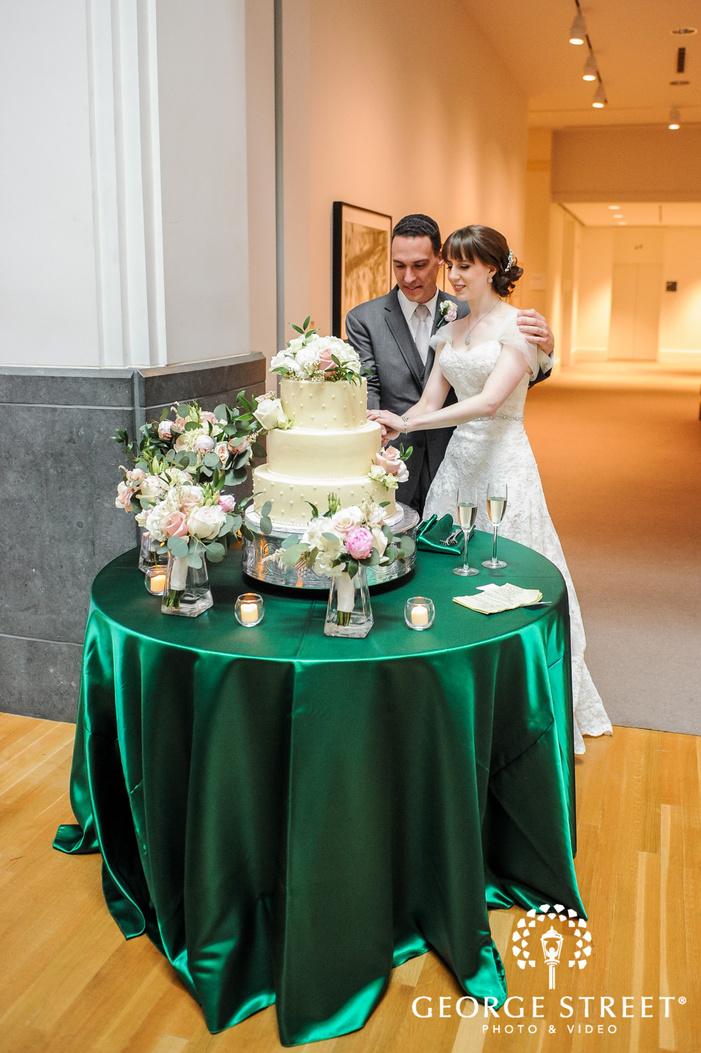 joyful bride and groom cake cutting wedding photo