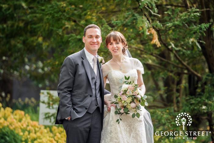 sweet bride and groom in green garden wedding photography
