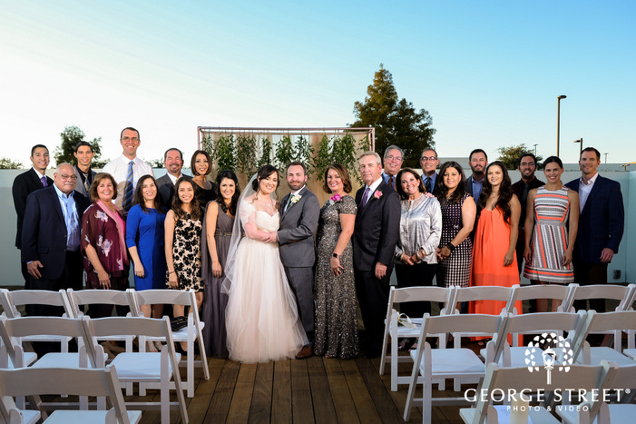 beautiful bride and groom with guests wedding photo