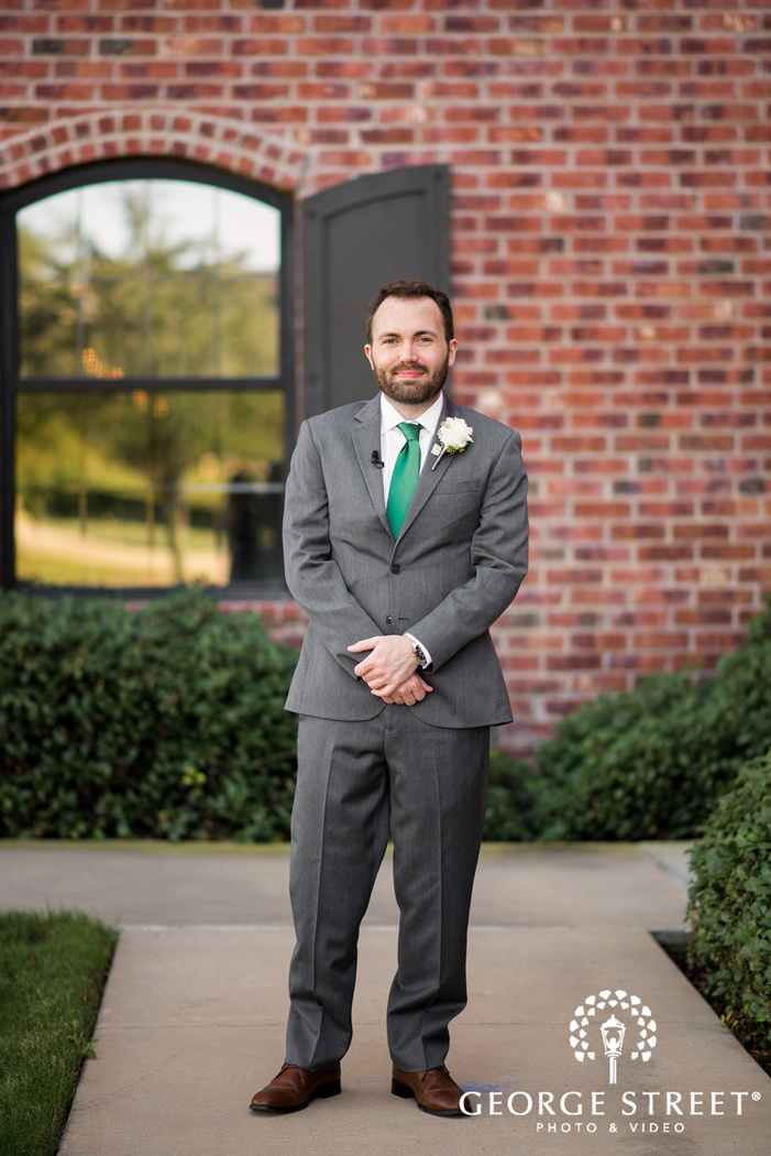 handsome groom at the nylo hotel in dallas