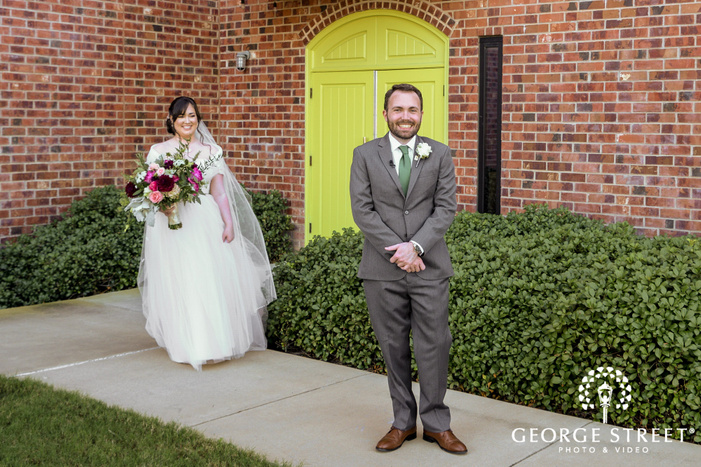handsome groom waiting for lovely bride in dallas