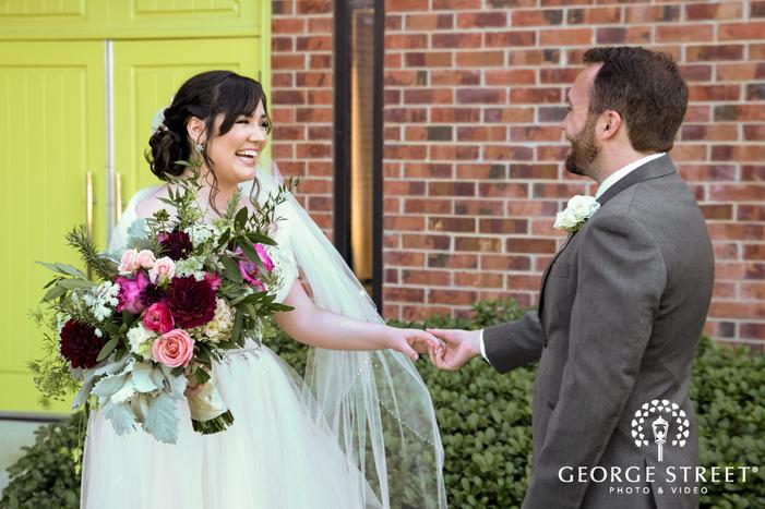 happy bride and groom at the nylo hotel in dallas
